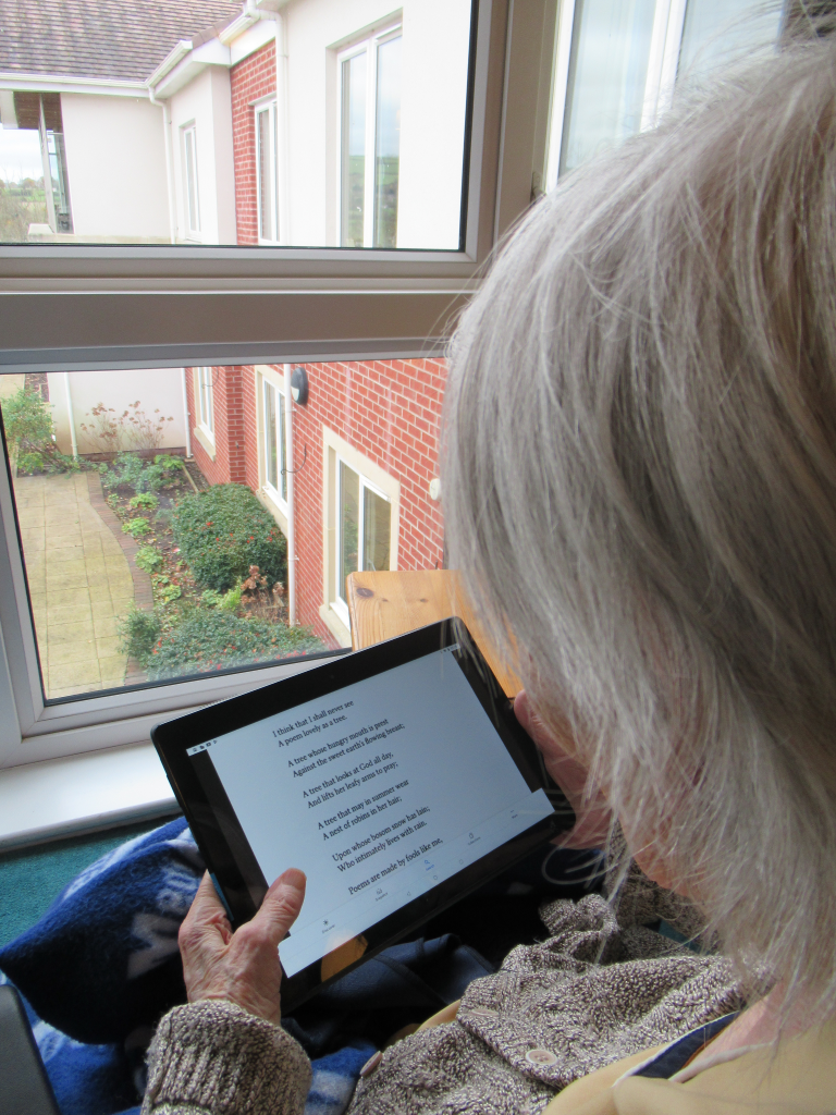 Resident of care home using iPad